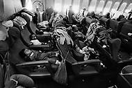 April 1975. Vietnamese orphans children in Airfrance flight going back to Paris for adoption.