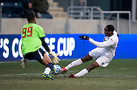 Leon Brown (9) of Notre Dame scores on Zack Steffen (99) of Maryland  during the NCAA Men's College Cup final at PPL Park in Chester, PA.  Notre Dame defeated Maryland, 2-1.