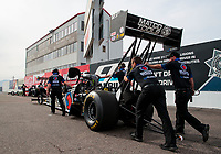 Feb 21, 2020; Chandler, Arizona, USA; Crew members push the dragster of NHRA top fuel driver Antron Brown during qualifying for the Arizona Nationals at Wild Horse Pass Motorsports Park. Mandatory Credit: Mark J. Rebilas-USA TODAY Sports