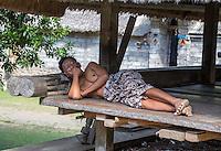 Bali, Indonesia.   Man Sleeping.  Tenganan Village.