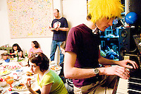 Phillip plays the piano while other freegans dine at a community meal in New York City on April 7, 2006.