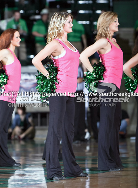 The North Texas Mean Green dance team in action during the NCAA Women's basketball game between the University of Louisiana at Monroe Warhawks and the University of North Texas Mean Green at the North Texas Coliseum,the Super Pit, in Denton, Texas. ULM defeated UNT 50 to 47.