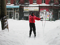 Residents of Brooklyn find interesting ways to get around as sidewalks are largely impassable during one of the largest blizzards to ever hit New York City, on February 17, 2003.