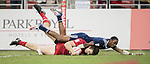 Perry Baker of USA fails to prevent Matt Mullins of Canada to score a try during the match United States vs Canada, the Cup Final of the HSBC Singapore Rugby Sevens as part of the World Rugby HSBC World Rugby Sevens Series 2016-17 at the National Stadium on 16 April 2017 in Singapore. Photo by Victor Fraile / Power Sport Images
