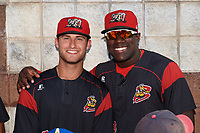 Batavia Muckdogs Bubba Hollins (34) and Lazaro Alonso (19) during the team autograph signing before a game against the Mahoning Valley Scrappers on August 30, 2017 at Dwyer Stadium in Batavia, New York.  Batavia defeated Mahoning Valley 5-1.  (Mike Janes/Four Seam Images)