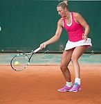 Yanina Wickmayer (BEL) defeats Caroline Wozniacki (DEN) 7-6, 4-6, 6-2 at  Roland Garros being played at Stade Roland Garros in Paris, France on May 27, 2014