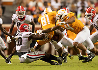 KNOXVILLE, TN - OCTOBER 5: Malik Herring #10 of the Georgia Bulldogs tackles Tim Jordan #9 of the Tennessee Volunteers during a game between University of Georgia Bulldogs and University of Tennessee Volunteers at Neyland Stadium on October 5, 2019 in Knoxville, Tennessee.