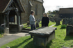 Hartfield East Sussex. St Mary the Virgin Church Hartfield. Nicholas Smith Bequest. 2014. The Rev'd Julie Sear and Mary ? who administers the Nicolas Smith Bequest wait at the tomb of Nicholas Smith. No one came forward to claim the annual dole thats given out on Good Friday.