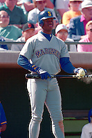 SCOTTSDALE, AZ - Ken Griffey Jr. of the Seattle Mariners waits in the on deck circle during a spring training game against the San Francisco Giants at Scottsdale Stadium in Scottsdale, Arizona in 1992. Photo by Brad Mangin