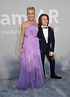 ANTIBES, FRANCE. July 16, 2021: Sharon Stone & Roan Joseph Bronstein at the amfAR Cannes Gala 2021, as part of the 74th Festival de Cannes, at Villa Eilenroc, Antibes.<br /> Picture: Paul Smith / Featureflash