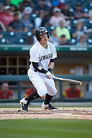 Brandon Guyer (11) of the Charlotte Knights follows through on his swing against the Toledo Mud Hens at BB&T BallPark on April 23, 2019 in Charlotte, North Carolina. The Knights defeated the Mud Hens 11-9 in 10 innings. (Brian Westerholt/Four Seam Images)