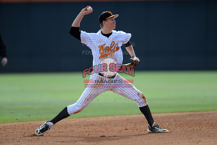 Tennessee Volunteers shortstop A.J. Simcox #10 throws to first during a game against  the Arizona State Sun Devils at Lindsey Nelson Stadium on February 23, 2013 in Knoxville, Tennessee. The Volunteers won 11-2.(Tony Farlow/Four Seam Images).