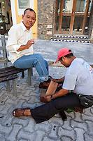 Shining Shoes, Playa del Carmen, Riviera Maya, Yucatan, Mexico.