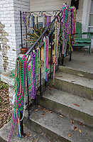 New Orleans, Louisiana.  Bead Necklaces Decorating Porch Railings after Mardi Gras.  Uptown.