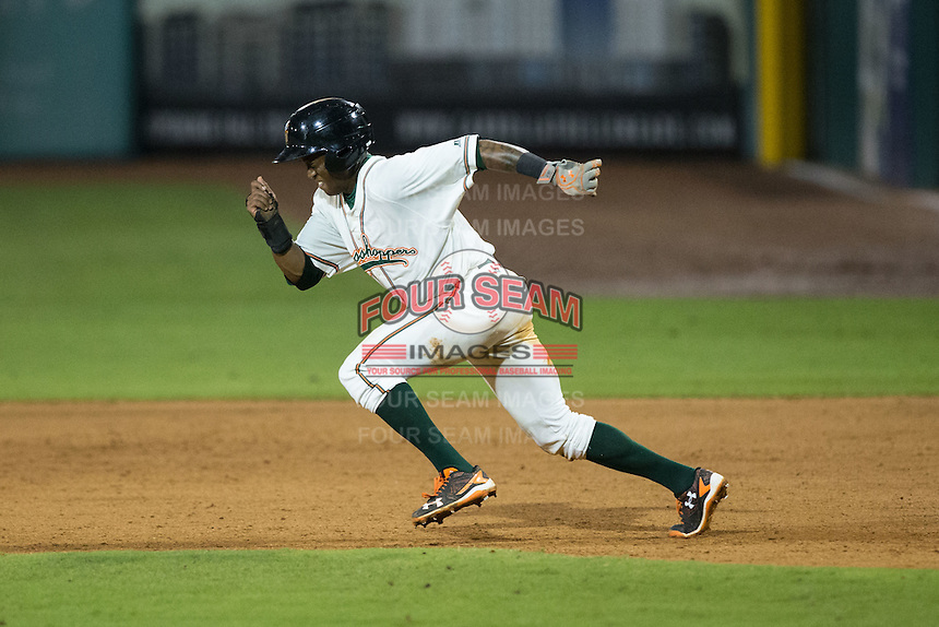 Anfernee Seymour (12) of the Greensboro Grasshoppers takes off for second base during the game against the Kannapolis Intimidators at NewBridge Bank Park on July 7, 2016 in Greensboro, North Carolina.  The Dash defeated the Pelicans 13-9.  (Brian Westerholt/Four Seam Images)