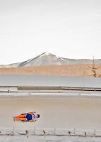 8 January 2016: Joska Le Conte, competing for the Netherlands, slides through Curve 14, with Whiteface Mountain as a backdrop, on her first run of the BMW IBSF World Cup Skeleton race at the Olympic Sports Track in Lake Placid, New York, USA. Mandatory Credit: Ed Wolfstein Photo *** RAW (NEF) Image File Available ***