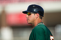 Greensboro Grasshoppers manager Kevin Randel (25) coaches third base during the game against the Kannapolis Intimidators at Intimidators Stadium on July 17, 2016 in Greensboro, North Carolina.  The Grasshoppers defeated the Intimidators 5-4 in game two of a double-header.  (Brian Westerholt/Four Seam Images)