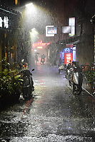 """Taipei Rain""  by Art Harman. While exploring Taipei's vibrant night market, the heavens opened up, creating this stormy view--highlighted by a lone streetlight. #Taiwan"