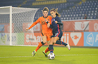 BREDA, NETHERLANDS - NOVEMBER 27: Alex Morgan #13 of the United States attempts to move past Dominique Janssen #20 of the Netherlands during a game between Netherlands and USWNT at Rat Verlegh Stadion on November 27, 2020 in Breda, Netherlands.