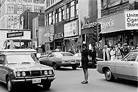 ARCHIVE -<br /> Brigadiere au Centre-Ville<br /> , rues Peel et Sainte-Catherine,<br /> en 1973,<br /> date exacte inconnue<br /> Photo : Agence Quebec Presse  - Alain Renaud