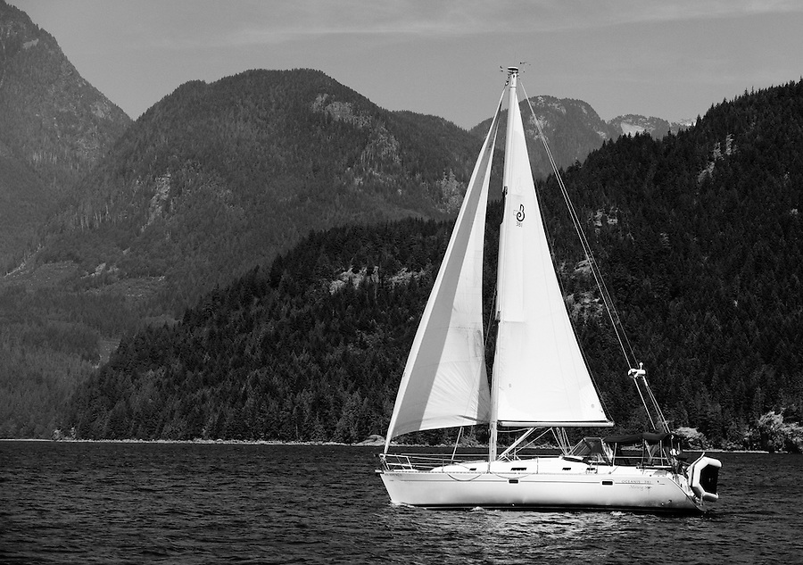 This sailboat is seen transiting Jervis Inlet along the coast of British Columbia on a warm summer day.