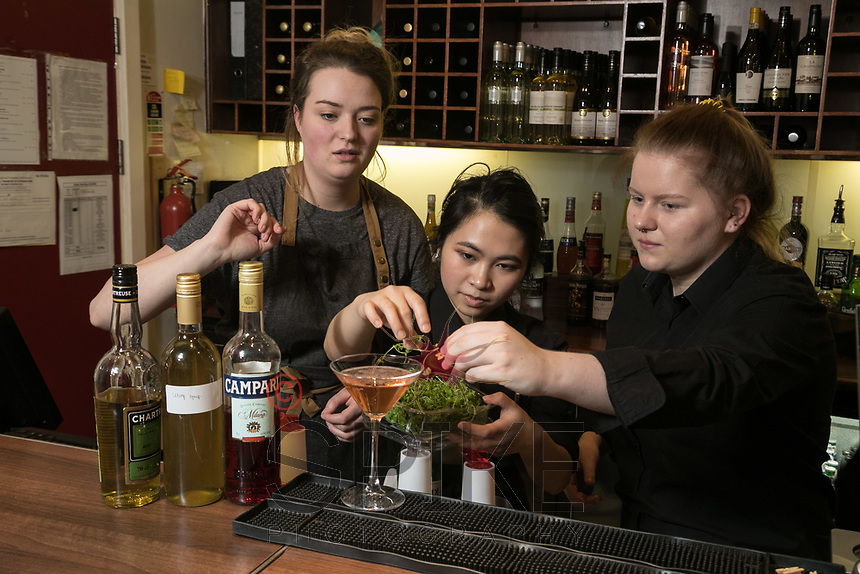 The Ruddington Arms Mixologist Grace Bond (left) creates some great cocktails with students Marianne Loa (centre) and Sophie Scroggie at the pub's Takeover Evening at the Adams Restaurant, Nottingham