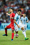 Marcos Acuna of Argentina (R) fights for the ball with Safuwan Baharudin of Singapure (L) during the International Test match between Argentina and Singapore at National Stadium on June 13, 2017 in Singapore. Photo by Marcio Rodrigo Machado / Power Sport Images