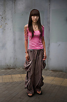 Taoshushan, a student, age 19, poses for a portrait in Beijing. Response to 'What does China mean to you?': 'My own country.'  Response to 'What is China's role in the future?': 'A developed country.'