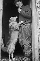 """Farmer with his working dog, Dunquin (in Gaelic, Dún Chaoin, meaning """"Caon's stronghold""""), on the tip of the Dingle Peninsula, County Kerry, Ireland.  1971."""