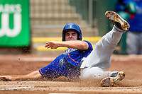 Tim Wheeler (7) of the Tulsa Drillers slides hard into home plate despite being tagged out up the line during a game against the Springfield Cardinals at Hammons Field on June 27, 2011 in Springfield, Missouri. (David Welker / Four Seam Images)