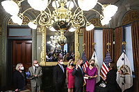 U.S. Vice President Kamala Harris, right swears in Bill Nelson, left, former Democratic Senator from Florida and administrator of the National Aeronautics and Space Administration (NASA), alongside his wife, Grace Nelson, holding the bible, in the Eisenhower Executive Office Building in Washington, D.C., U.S., on May 3, 2021. The Senate confirmed Nelson on April 29 and had served as the chairman and ranking member of the Senate subcommittee that oversees NASA. <br /> Credit: Oliver Contreras / Pool via CNP /MediaPunch