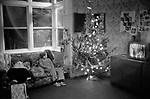 Richmond, London, 1975 <br /> A quiet moment during the first Christmas at the Palm Court Hotel, Chiswick Women's Aid. The Playboy Bunny Club hosted the Christmas celebrations that year.