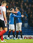 Nicky Clark celebrates his goal with captain Lee McCulloch