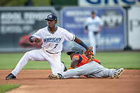 West Michigan Whitecaps second baseman Jeremiah Burks (7) applies a tag at second against Bowling Green Hot Rods baserunner Tony Pena on May 21, 2019 at Fifth Third Ballpark in Grand Rapids, Michigan. The Whitecaps defeated the Hot Rods 4-3.  (Andrew Woolley/Four Seam Images)