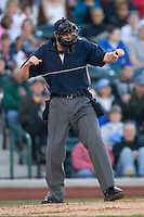 Home plate umpire Brandon Henson calls a batter out on strikes during the Midwest League game between the Dayton Dragons and the Fort Wayne Tin Caps at Parkview Field April 16, 2009 in Fort Wayne, Indiana. (Photo by Brian Westerholt / Four Seam Images)