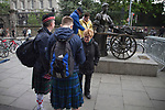 Scotland 3  Wales 1, 25/05/2011. Aviva Stadium, Carling Nations Cup. Two Scotland fans wearing kilts chatting to a passer-by next to the statue of Molly Malone in the centre of Dublin as they make their way to Aviva Stadium for the Carling Nations Cup match between Scotland and Wales. Scotland won the match by 3 goals to 1.The multi-sports venue was originally known as Lansdowne Road and was reopened in 2010 after it was completely redeveloped. Photo by Colin McPherson.
