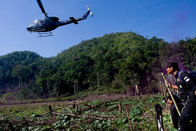 Police prepare to clear a a village during a forced eviction of an illegal community inside the Mayan Biosphere.