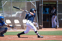 AZL Padres 1 left fielder Tyler Benson (30) follows through on his swing in front of catcher Stephan Vidal (13) during an Arizona League game against the AZL Royals at Peoria Sports Complex on July 4, 2018 in Peoria, Arizona. The AZL Royals defeated the AZL Padres 1 5-4. (Zachary Lucy/Four Seam Images)