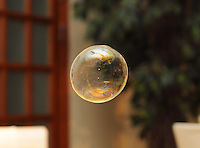 Soap bubble with roomt on background