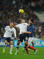 Clint Dempsey of team USA and Laurent Koscielny of France fight for the ball during the friendly match France against USA at the Stade de France in Paris, France on November 11th, 2011.