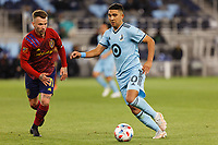 SAINT PAUL, MN - APRIL 24: Emanuel Reynoso #10 of Minnesota United FC goes the strike the ball during a game between Real Salt Lake and Minnesota United FC at Allianz Field on April 24, 2021 in Saint Paul, Minnesota.