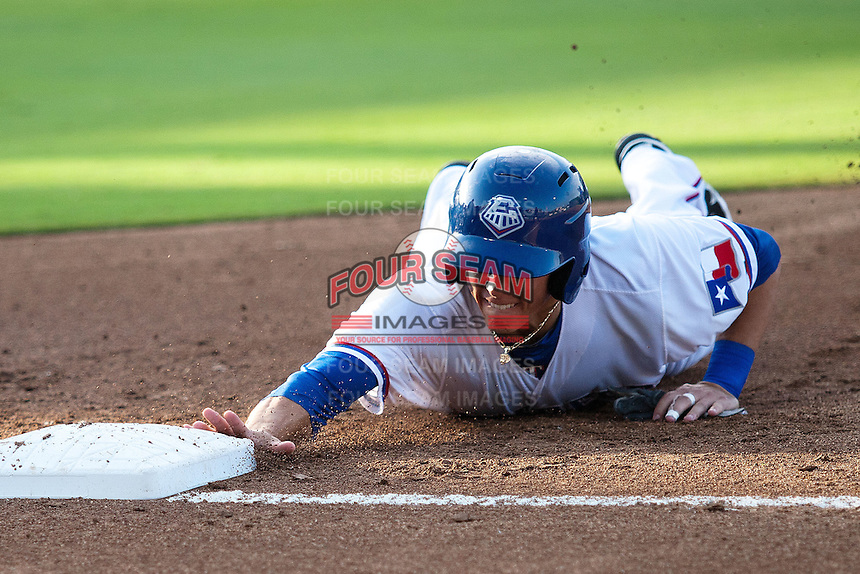 Round Rock Express second baseman Greg Miclat #1 dives back to first base during a pick off attempt in the first inning of the Pacific Coast League baseball game against the Omaha Storm Chasers on July 22, 2012 at the Dell Diamond in Round Rock, Texas. The Express defeated the Chasers 8-7 in 11 innings. (Andrew Woolley/Four Seam Images)..