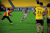 A pitch invader is chased by security during the Super Rugby Tran-Tasman match between the Hurricanes and Rebels at Sky Stadium in Wellington, New Zealand on Friday, 21 May 2020. Photo: Dave Lintott / lintottphoto.co.nz