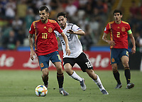 Spain's Dani Ceballos, left, is chased by Germany Suat Serdar during the Uefa Under 21 Championship 2019 football final match between Spain and Germany at Udine's Friuli stadium, Italy, June 30, 2019. Spain won 2-1.<br /> UPDATE IMAGES PRESS/Isabella Bonotto