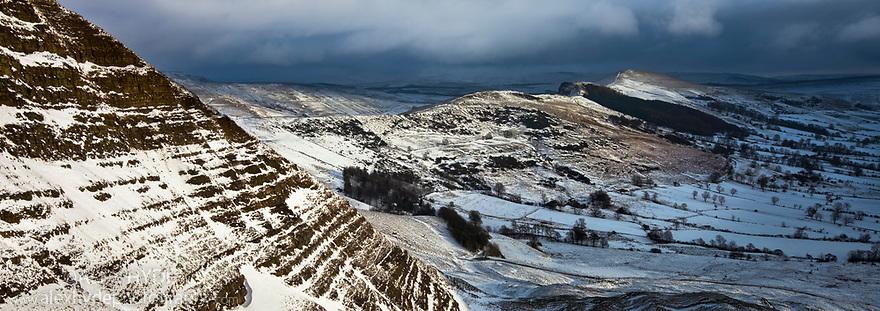 Snow stom bearing down on Mam Tor and the Great Ridge above Castleton, Peak District National Park, Derbyshire, UK. December.