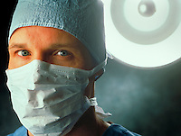 Portrait of male doctor wearing surgical mask. Billboard and broadcast must be negotiated, due to talent agreement. United States Hospital.