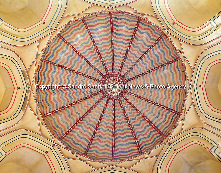 Pictured: Amber Palace in Jaipur, India. <br /> <br /> A series of photographs of ceilings from historic buildings show off kaleidoscopic patterns.  Italian photographer Sandro Santioli captured the mesmerising and intricately decorated interiors of some of Istanbul's grandest places of worship.<br /> <br /> The symmetry of the designs adorning ceilings in Topkapı Palace, Sultan Ahmed Mosque and Hagia Sophia Grand Mosque create kaleidoscopic patterns.  As well as Istanbul, Turkey, Mr Santioli photographed ceilings at the Amber Fortress in Jaipur, India.  SEE OUR COPY FOR DETAILS. <br /> <br /> Please byline: Sandro Santioli/Solent News<br /> <br /> © Sandro Santioli/Solent News & Photo Agency<br /> UK +44 (0) 2380 458800