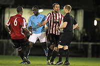 Elliot Styles of Hornchurch confronts referee Carl Fitch after a foul by Joe Benjamin (2nd L) - AFC Hornchurch vs Billericay Town - Blue Square Conference South Football at The Stadium, Upminster Bridge, Essex - 29/12/12 - MANDATORY CREDIT: Gavin Ellis/TGSPHOTO - Self billing applies where appropriate - 0845 094 6026 - contact@tgsphoto.co.uk - NO UNPAID USE