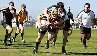 Sheridan Cantlin crosses the line to score a try for NAVY with Craig Sheridan of Colorado State University on his back at the San Diego Invitational Rugby tournament in Rob Field, Ocean Beach San Diego, Thursday February 7 2008.  Navy won the match 17 -10 with a late converted try.  The tournament is being held  in conjunction with the USA 7?s International Rugby at PETCO Park on February 9th & 10th.