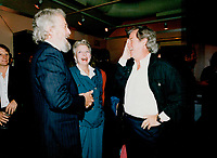 1989 FILE PHOTO - ARCHIVES -<br /> <br /> Director Alan King (left) chats with with actress Charmion King (no relation) and her husband, actor Gordon Pinsent, at The Bellair Cafe.